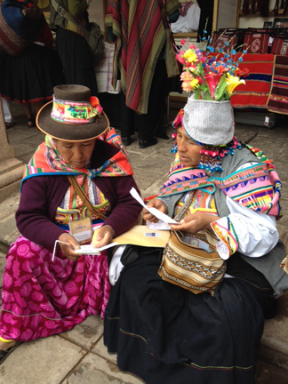 Hats express individuality, community solidarity, and joy among Andean weavers.