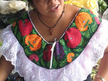 Closeup of a cross-stitched yoke from Bachajon.