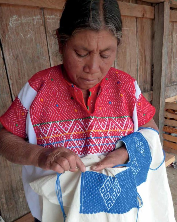 From Mayan Hands: A Woven History of Chiapas. An embroiderer from Los Lotes. Photograph by Chip Morris.
