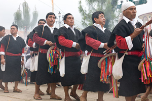 Men in procession during Santa Semana. Photo by Joe Coca