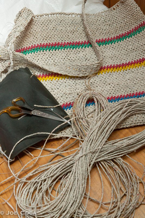 A traditional-style bag in an intricate looped construction, made from chicken sacks.