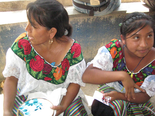 Girls in the market at Abosolo wear the popular style of a separately made cross-stitch yoke with lace trim on a simple white huipil.