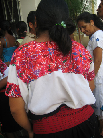 In this style of huipil in El Bosque, the square cross stitch yoke is worked directly on the fabric of the huipil.