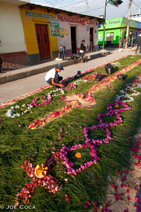 Flower carpets, called alfombras, mark the path of processions that last late into the night.