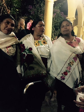 Three women from Huixtan, where embroidery is the fashion.