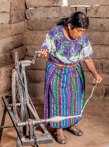 Ana Pu Ferpuac spinning wool. Photo by Joe Coca.